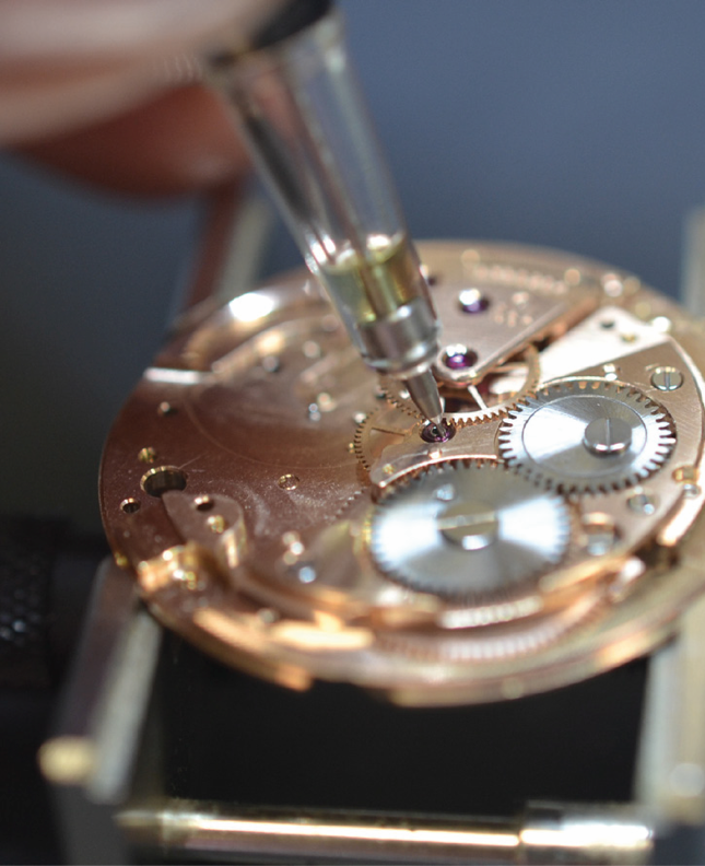 watch repair and servicing - lubricating the movement